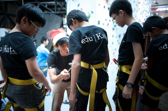 last check before we head out- eduKate Students gets final safety check by Climb Central Staff. Learning a new skill, equipment and peripheral in a short amount of time is the lesson here.