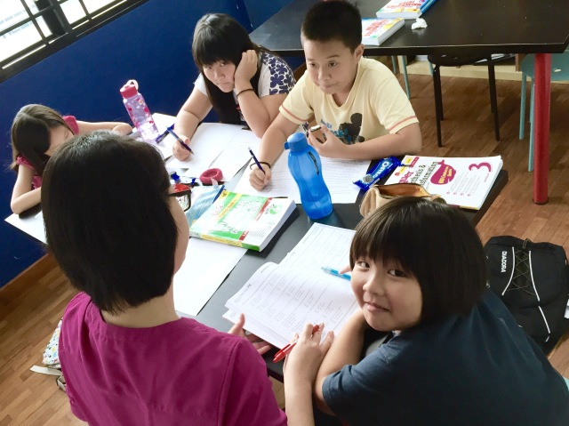 SEAB PSLE Syllabus Primary 3/4 English Tuition. Class doing Vocabulary, Grammar, Synthesis. Poi Ching Primary and Mee Toh Primary