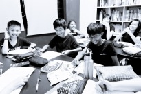 PSLE Students doing an English Tuition class in small group format, enjoying their lesson helps them to feel good about what they learn